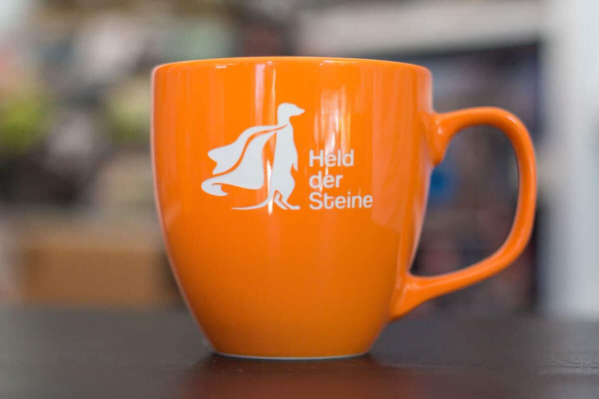 Held der Steine Logo - Tasse in Orange