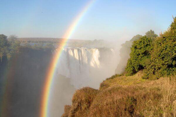 Simbabwe Victoria Falls Wasserfaelle Regenbogen
